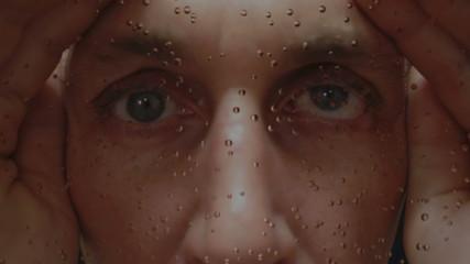 Spying Male Eyes Through Rainy Window