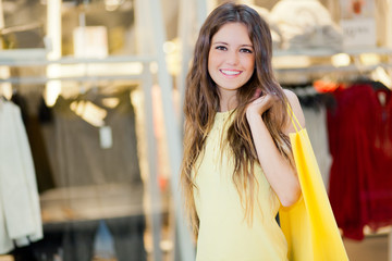 Young smiling woman shopping in the city
