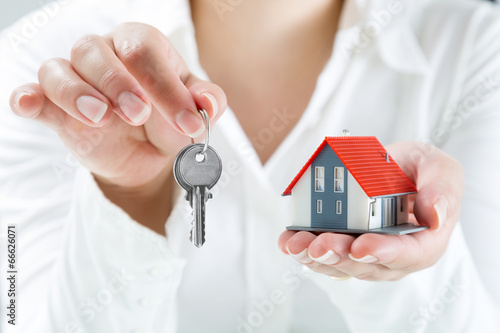 real estate agent handing over keys to home - 66626071