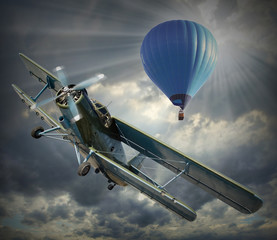 Retro style picture of the biplane and hot air balloon.
