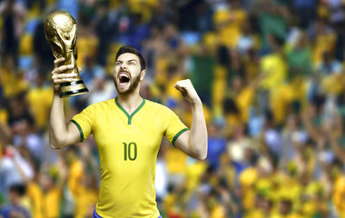 Brazilian soccer player celebrates holding a trophy - stadium