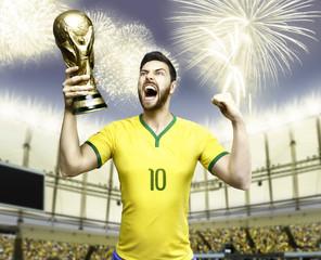 Brazilian soccer player celebrates holding a trophy - stadium