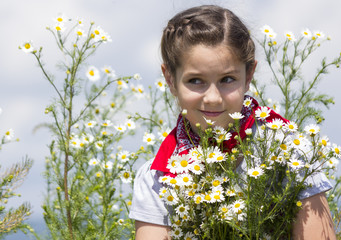 Young girl on a chamomile field
