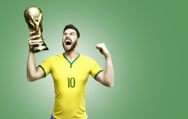 Brazilian soccer player celebrates holding a trophy