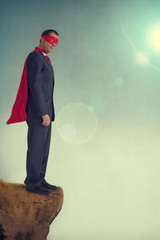 superhero businessman on a precipice