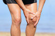 Runner injury - Man running with knee pain