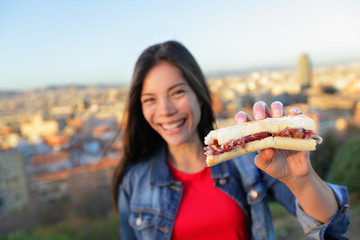 Jamon Iberico Sandwich - woman eating in Barcelona