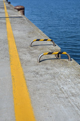 yellow line on the ground over the pier