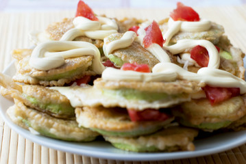 Courgette pancakes with mayonnaise and tomato