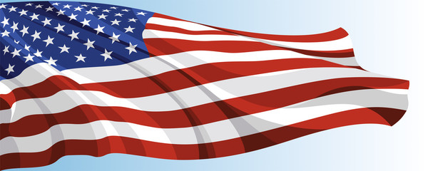 The national flag of the USA on a background of blue sky