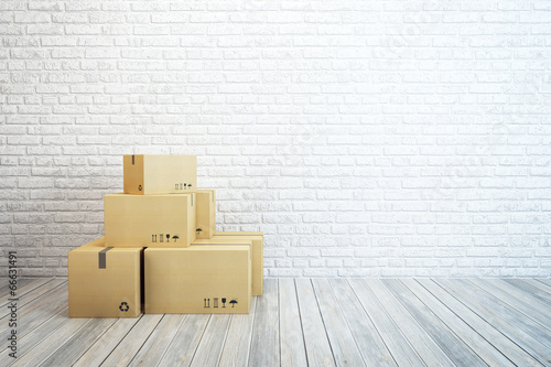 moving boxes at a new home - 66631491