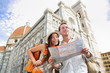 Tourist travel couple by Florence cathedral, Italy