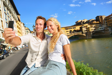 Happy couple selfie photo on travel in Florence