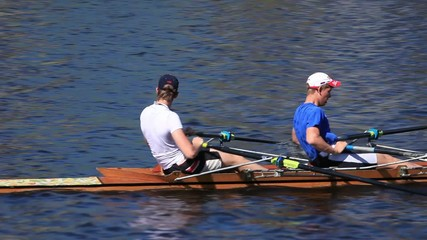Sculling Two men rowing tracking shot