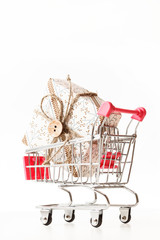 Christmas presents in shopping trolley