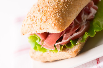 Prosciutto sandwich on plate macro