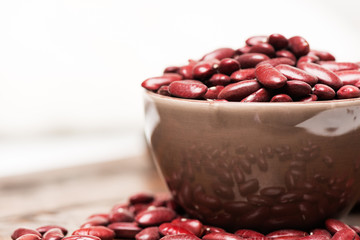 Bowl with raw red beans macro horizontal
