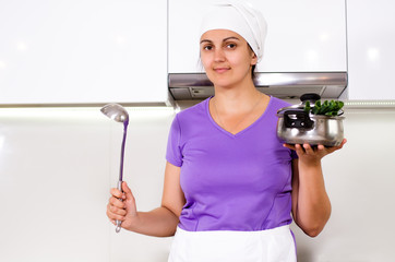 Female cook in her kitchen
