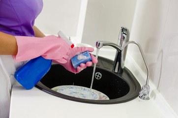 Woman doing the washing up