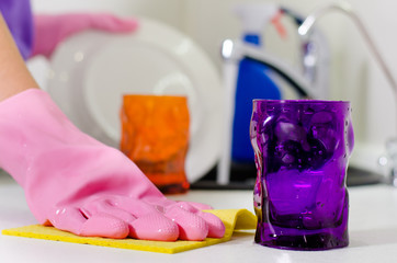 Woman wiping the kitchen counter top