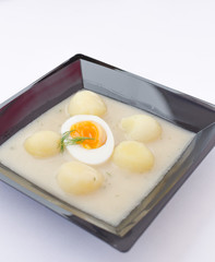 Creamy dill sauce with boiled egg and chateau potatoes.