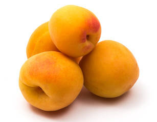 Four apricot on white background