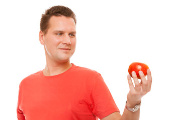 Happy man in red shirt holding apple. Diet health