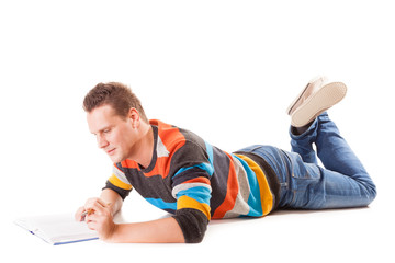 male student reading a book preparing for exam isolated