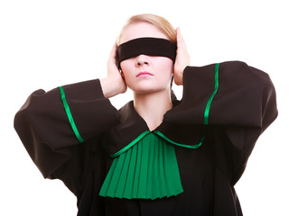 Woman lawyer attorney in polish black green gown with blindfold