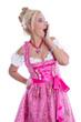 Erstaunte Frau freigestellt in rosarotem Dirndl aus Bayern