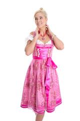 Frau freigestellt in pinkfarbenem Dirndl Kleid aus Bayern