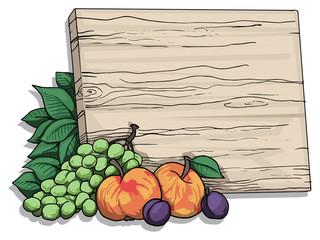 wooden writing board with various fruit around it