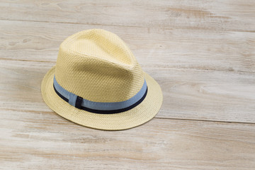 New Straw Hat on Faded Wood