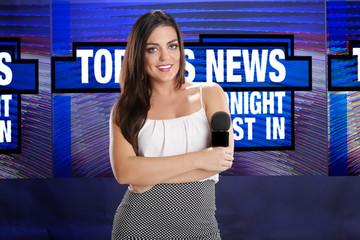 Confident anchorwoman sets for interview