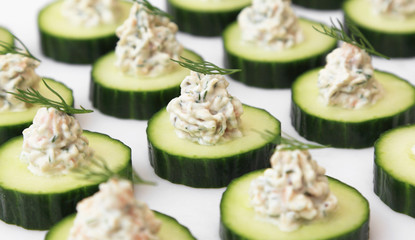 Salmon mousse served on cucumber slices, garnished with dill