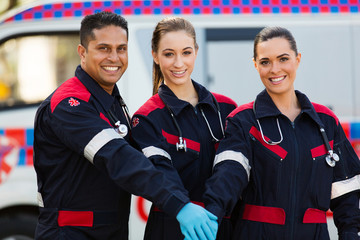 group of paramedics hands together