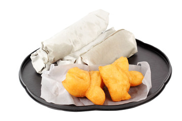 deep fried dough stick and Roti flat bread in paper wrap
