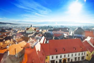 Red roofs and shining sun in Sibiu, Romania