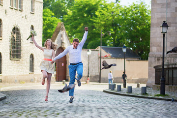 Happy just married couple jumping