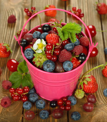 Various berries in a bucket