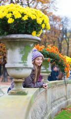 Cheerful young girl enjoying a fall day