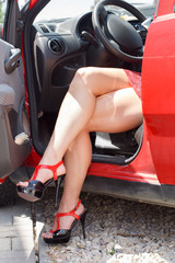 Luxury woman with sexy legs in car