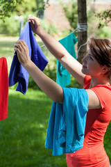 Housewife hanging the laundry