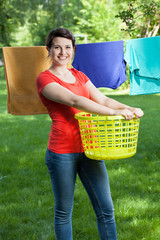 Smiling woman with laundry