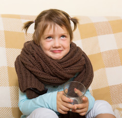 Smiling child dressed in warm  scarf