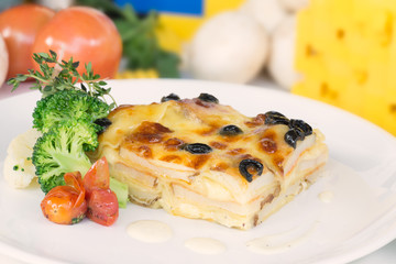 Vegetable lasagne on a white plate close-up