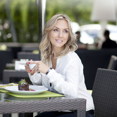 Attractive blonde young woman in cafe