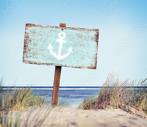 Blue Painted Wood Label on Beach - 66648456