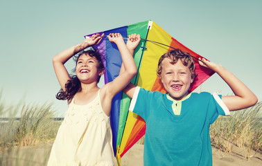 Children Playing with the Kite Outdoors