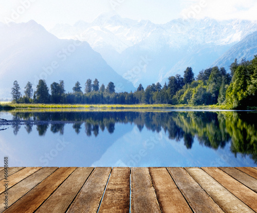 Foto op Canvas Meer / Vijver Mountain Range and a Body of Water